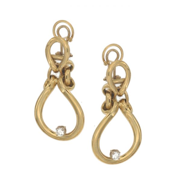 Earrings in yellow gold with white zircons